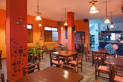 Plentiful Restaurant Seating And View Toward Kitchen