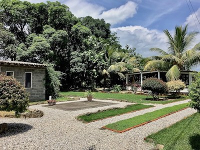 34 Two bedroom +office House to the left_ backyard center_drive to the enterance of the Finca to the left.jpg