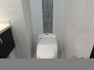 Master Bathroom Toilet And Nice Tile Work.