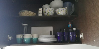 7 Kitchen Storage In Suite.jpg