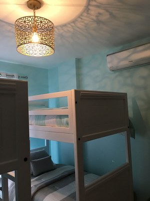 second bedroom with bunk beds and designer lighting