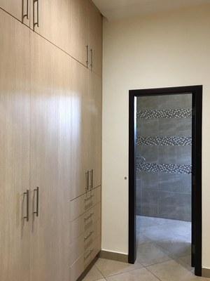 floor-ceiling cabinets in master bedroom walk-in closet.jpg