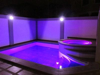 pool & jacuzzi iluminated at night.JPG