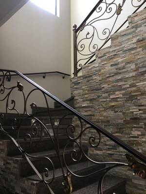 granite staircase with custom iron work railings .jpg