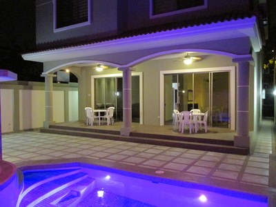 back patio and pool area lit up at night.JPG
