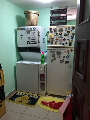 Laundry Room With Full Size Refrigerator